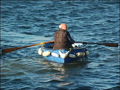 Man rows 135 km upstream in 2.7 hours. Find the Speed of the man.